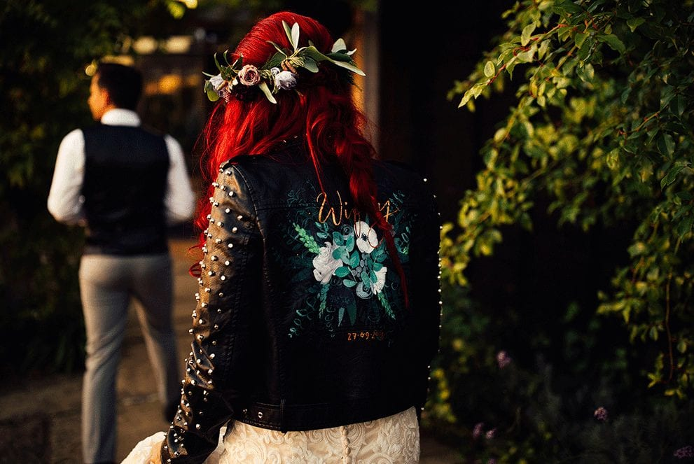 Bride wearing a hand painted funky, edgy leather jacket