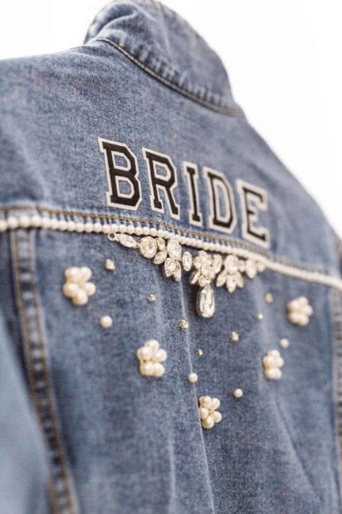 Bride wearing a hand painted funky, edgy leather denim